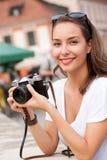 Brunette beauty taking photo. Royalty Free Stock Photos
