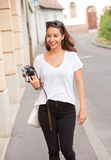 Brunette beauty taking photo. Stock Images