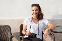 Brunette beauty taking photos. Stock Image