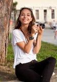 Brunette beauty taking photos. Royalty Free Stock Photo