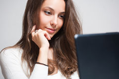 Brunette beauty using laptop. Royalty Free Stock Photography