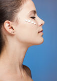 Brunette beauty using lotion. Royalty Free Stock Image