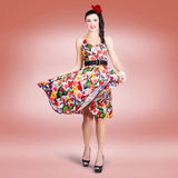Brunette beauty wearing a colourful summer dress Royalty Free Stock Photos