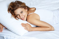 Brunette in bed royalty free stock photo