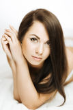 Brunette in bed Stock Images