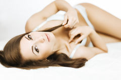 Brunette in bed Stock Photo