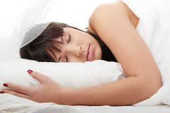 Brunette in bed sleeping Royalty Free Stock Photos