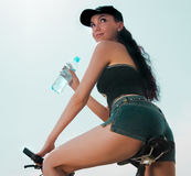 Brunette on the bicycle Stock Photography