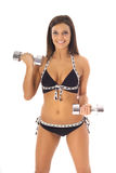 Brunette in bikini staying fit. Shot of a brunette in bikini staying fit Royalty Free Stock Photography