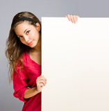 Brunette billboard beauty. Stock Photography