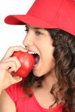 Brunette biting into apple Royalty Free Stock Photos