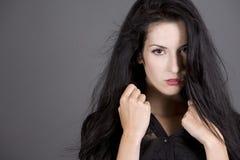 Brunette in black Stock Images