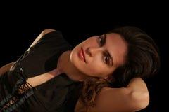 Brunette on black. Beautiful sensual brunette laying, portrait on black background Royalty Free Stock Photos