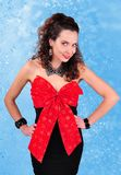 Brunette in a black dress with a big  red bow Stock Photo