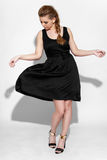 Brunette in black dress Stock Images