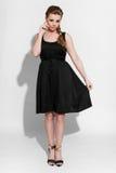 Brunette in black dress Royalty Free Stock Images