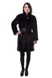 Brunette in black fake fur coat Royalty Free Stock Photo