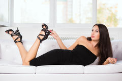 Brunette in black fitting dress Stock Image