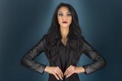 Brunette in a black jacket Royalty Free Stock Images