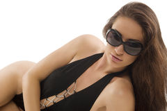 Brunette in black swimsuit laying Royalty Free Stock Photos