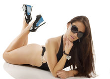 Brunette in black swimsuit laying Royalty Free Stock Photography