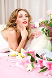 Brunette blond model with flowers Stock Image