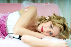 Brunette blond model laying on sofa Stock Photos