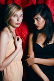 Brunette and blond woman together, conflict of Royalty Free Stock Photography