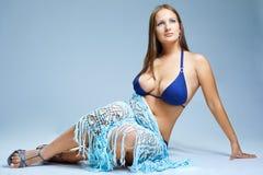 Brunette in blue bikini Royalty Free Stock Image