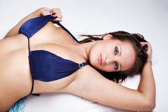 Brunette in blue bikini Royalty Free Stock Images
