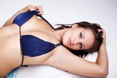 Brunette in blue bikini Royalty Free Stock Images