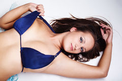 Brunette in blue bikini Royalty Free Stock Photos