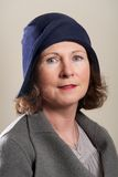 Brunette in blue cloche hat and jacket Royalty Free Stock Photos