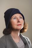 Brunette in blue cloche hat looking up Stock Photo