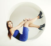 Brunette in blue dress sitting in a circle Stock Photo