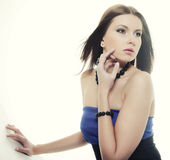 Brunette in blue dress sitting in a circle Royalty Free Stock Photography