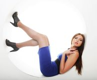brunette in blue dress sitting in a circle Royalty Free Stock Images