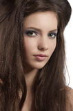 Brunette with blue eye makeup Stock Images