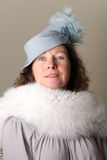 Brunette in blue feathered hat and fur Royalty Free Stock Photos