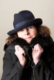 Brunette in blue hat and black jacket Royalty Free Stock Photo