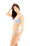 Brunette in blue lingerie Stock Photos