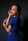 Brunette in blue Stock Photos