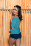 Brunette in blue. Pretty young brunette in a turquoise knit blouse royalty free stock photos