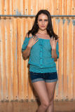 Brunette in blue. Pretty young brunette in a turquoise knit blouse royalty free stock photo