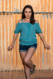 Brunette in blue. Pretty young brunette in a turquoise knit blouse stock images