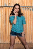 Brunette in blue. Pretty young brunette in a turquoise knit blouse stock photography
