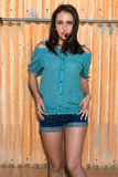 Brunette in blue. Pretty young brunette in a turquoise knit blouse stock image