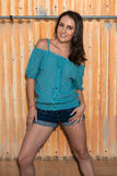 Brunette in blue. Pretty young brunette in a turquoise knit blouse royalty free stock image