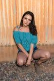 Brunette in blue Stock Images