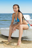 Brunette in blue swimsuit Royalty Free Stock Photography